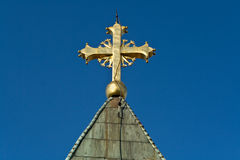 Golden cross on church Royalty Free Stock Image
