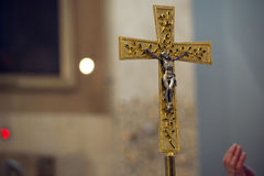 Golden cross in a church Royalty Free Stock Photo
