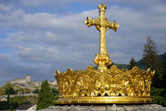Golden cross and crown Stock Photo