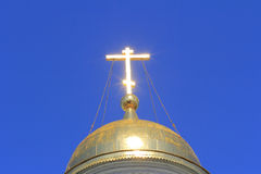 The Golden cross on the dome. Of the Church from which reflects the suns rays. Looks very symbolic character of Holiness and enlightenment in faith Stock Images