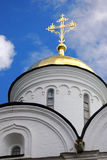 Golden cross on the golden church cupola. Stock Image