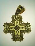 Golden cross jewel. Antique golden cross jewel width outer glow Royalty Free Stock Photography