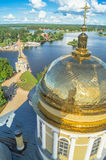 Golden cross on the main dome of the Epiphany Cathedral, Nilov Monastery, Tver region. In the background you can see the coastline of peninsula Svetlitsa and Royalty Free Stock Images