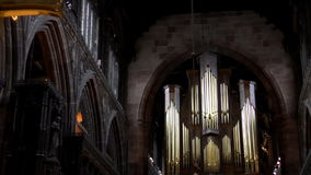 Golden cross in a Manchester Cathedral stock video
