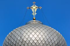 Golden cross on metal dome roof of an orthodox church, Ukraine.  royalty free stock photos