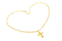 Golden Cross necklace. Display with love heart shape isolated on white background stock images