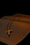 Golden Cross necklace on an open Bible Stock Photo
