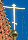 The golden cross on the Orthodox Temple against the blue sky.  Royalty Free Stock Images