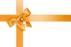Golden cross ribbon with bow Stock Photos
