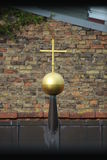 Golden Cross On The Roof Stock Photos