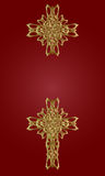 Golden cross. Two gold knitted a cross on a red background Stock Photography
