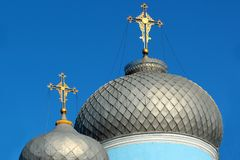 Golden crosses on metal dome roofs of an orthodox church, Ukraine.  royalty free stock images