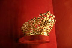 Golden crown. A golden crown on red velvet display Royalty Free Stock Photography