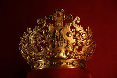 Golden crown. A golden crown on red velvet display Royalty Free Stock Photos