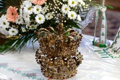 Golden crown at the altar in the church for the wedding couple traditional religious wedding ceremony.  Royalty Free Stock Photography