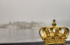 Golden crown and city in mist. Stock Image