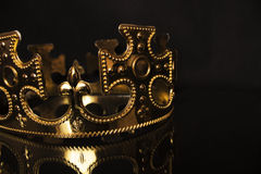 Golden crown on a dark background Stock Image
