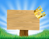 Golden crown hanging on sign Stock Image