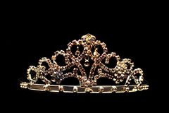 Golden crown isolated. Nice golden crown isolated on the black background Royalty Free Stock Photo