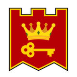 Golden crown and key on coat of arms. Made in cartoon style. stock photography