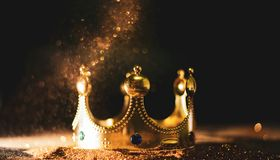 The golden crown of the king onGold abstract bokeh background