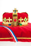 Golden crown on velvet pillow with Dutch flag Stock Photo