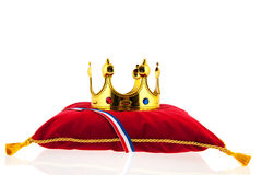Golden crown on velvet pillow with Dutch flag Stock Image
