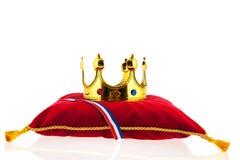 Golden crown on velvet pillow with Dutch flag. Golden crown on red velvet pillow for coronation in Holland Stock Image