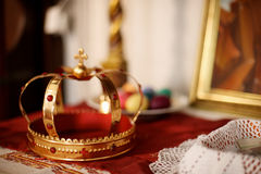 A golden crown. With rubies on the altar with donations in the Orthodox Church Royalty Free Stock Photos
