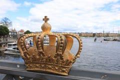 Golden crown on Skeppsholm bridge ,Stockholm , Sweden royalty free stock image