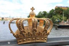 Golden crown on Skeppsholm bridge ,Stockholm , Sweden royalty free stock photography