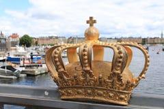 Golden crown on Skeppsholm bridge ,Stockholm , Sweden royalty free stock photos