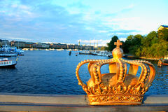 Golden Crown on a Skeppsholmsbron bridge. Stockholm, Sweden Royalty Free Stock Image