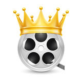 Golden crown on  tape reel Royalty Free Stock Photos