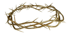 Golden Crown Of Thorns. Branches of thorns made of gold woven into a crown depicting the crucifixion on an isolated background Royalty Free Stock Photo