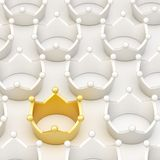 Golden crown among white ones Stock Photography