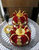 Golden crowns and a glass of wine for orthodox wedding Stock Photography