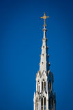 Golden Crucifix Atop Tall Church Steeple Royalty Free Stock Image