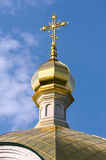 Golden crucifix and Cupola of Orthodox church Stock Image