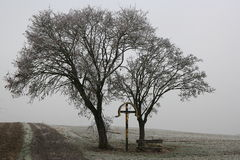 Golden crucifixion memorial in dull landscape Royalty Free Stock Photo