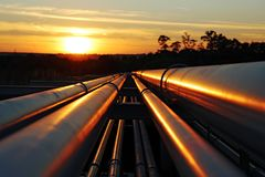 Golden crude pipelines in africa royalty free stock photo