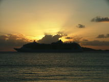 Golden Cruise. Cruise ship leaving port at sunset Stock Photography