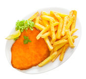 Golden crumbed veal schnitzel with potato chips Royalty Free Stock Photo