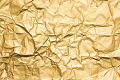 Golden crumpled foil paper texture abstract background. Aged golden crumpled foil paper texture abstract background. Copy space royalty free stock image