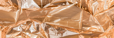 Golden crumpled foil texture. For background royalty free stock photography