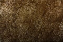 Golden crumpled wrapping paper Royalty Free Stock Photos