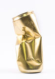 Golden crushed, deformed can on a white background Stock Images