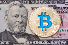 Golden cryptocurrency blue bitcoin on fifty dollar banknote back Stock Photos