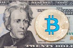 Golden cryptocurrency blue bitcoin on twenty dollar banknote bac Stock Photo