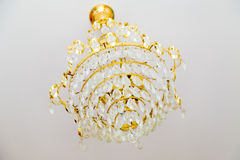 Golden  crystal chandelier. Classical crystal chandelier on white background Royalty Free Stock Photography